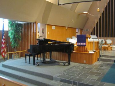 We've a piano AND behind where the choir is at.I worship in the choir.